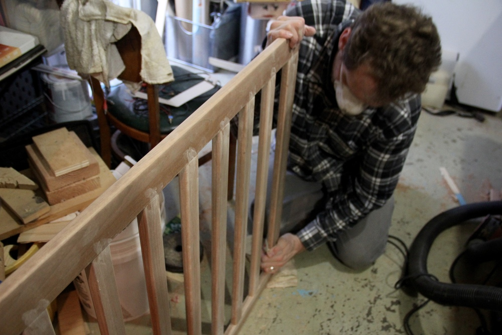 More sanding the crib