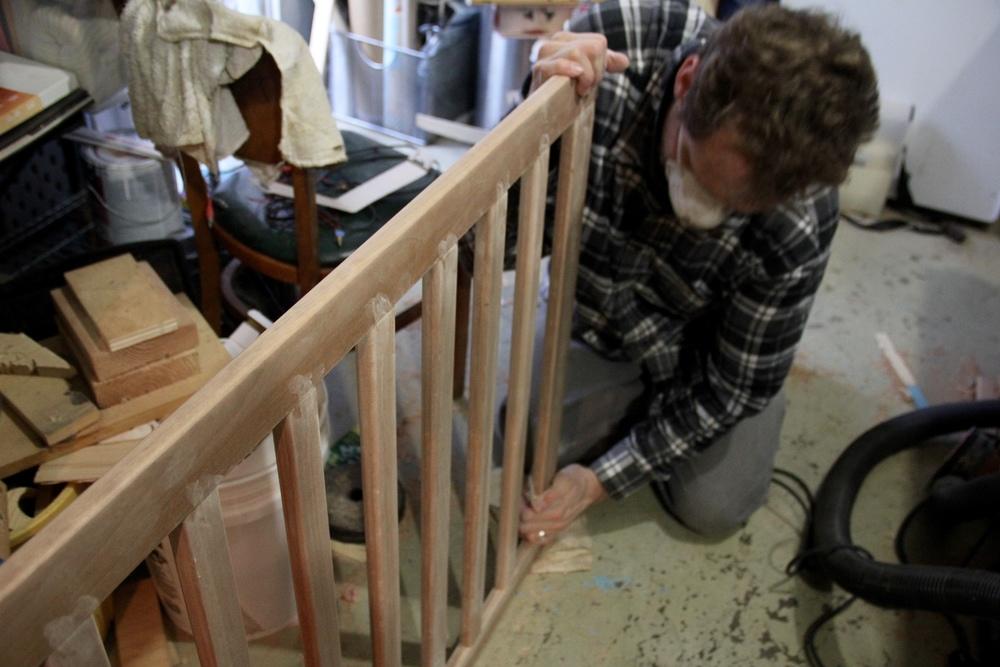 More sanding the crib