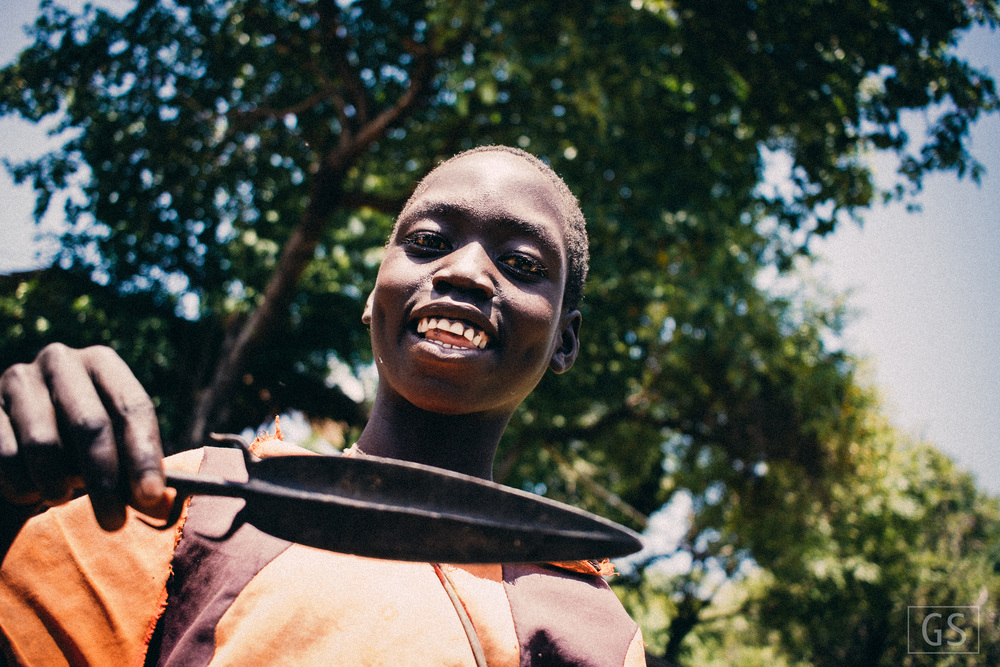 Lopit child holding a spear part. [Ohilang, South Sudan, 2015]