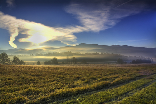 Cades Cove at sunrise. Photo courtesy of Ben M (birdnerd25) via  Flickr .