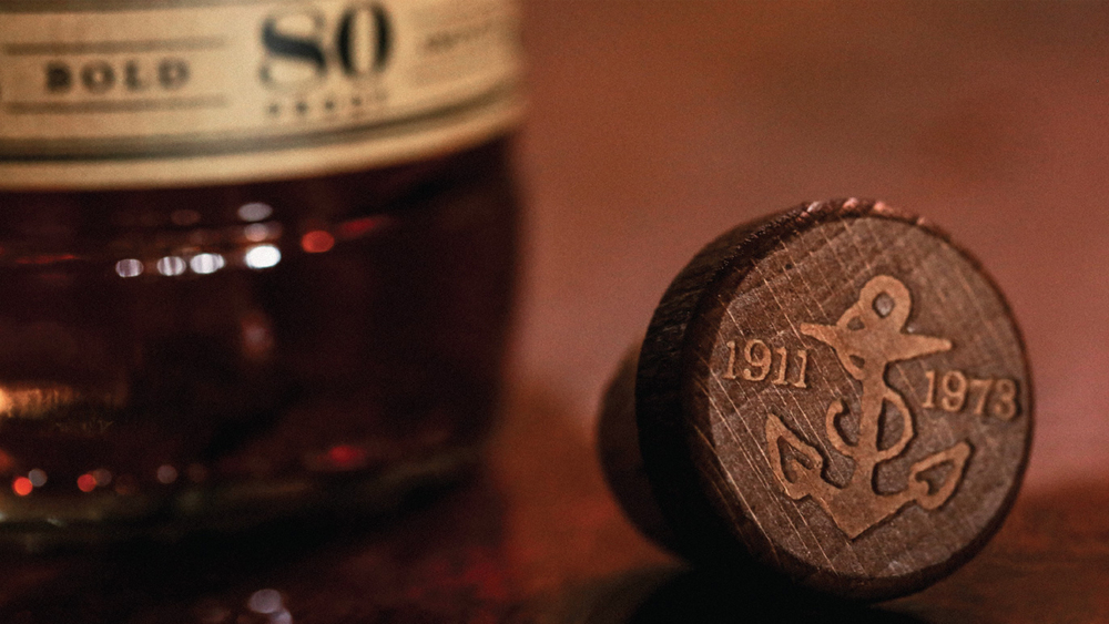 The bottle's cork showing the birth and death dates of the artist Sailor Jerry.