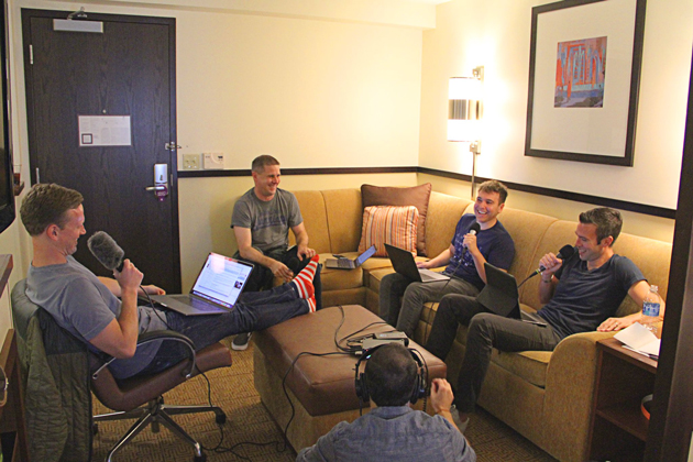 Tommy Vietor (left), Jon Lovett (right) and Jon Favreau (far-right) recording a show.