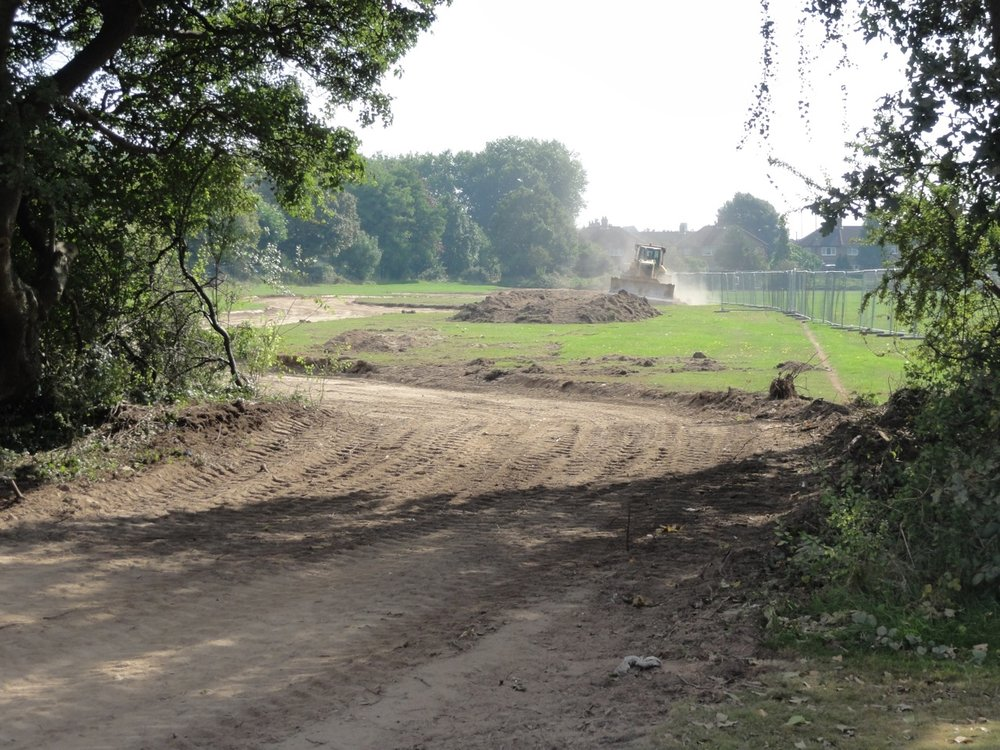The shape of the watercourse is marked as the topsoil is stripped
