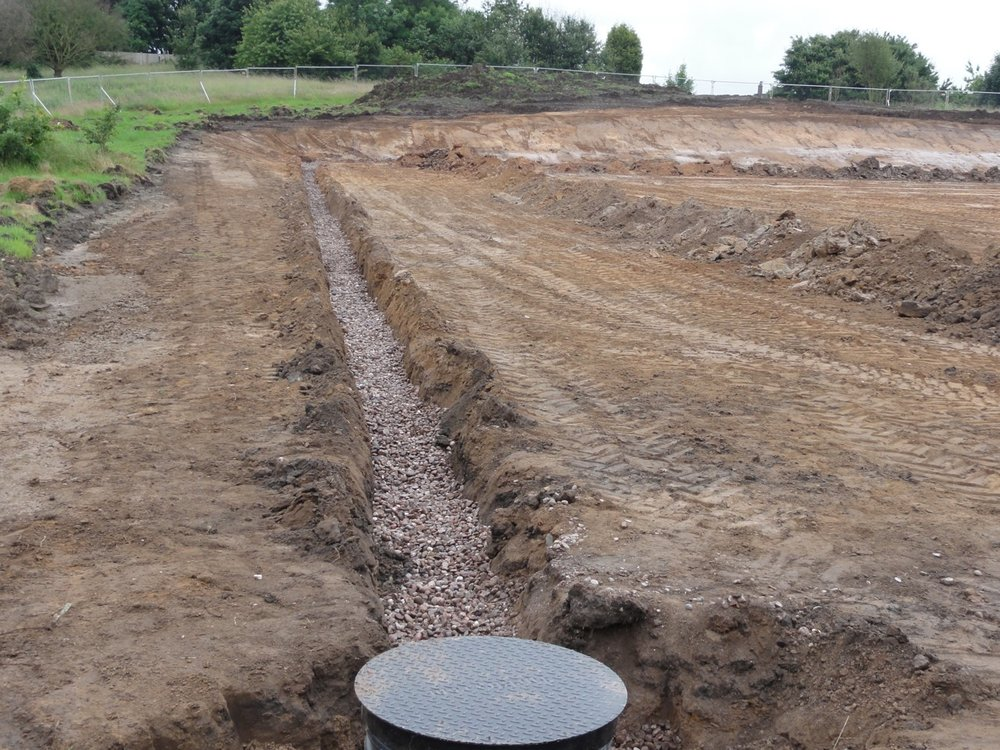 To combat the difficult ground conditions, a deep drainage system had to be installed before work could properly begin on the pitches. Following its installation, the deep drainage system successfully de-watered the site.