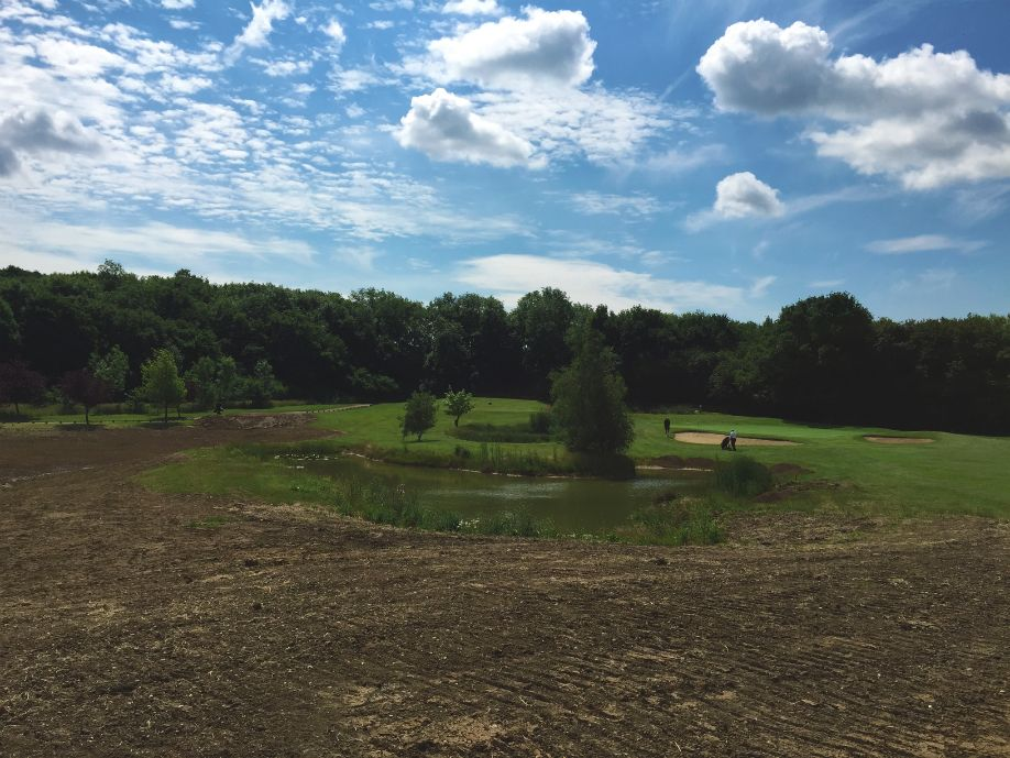 Excavated material from pond construction has been incorporated into the course landscape, and will soon blend in with beautiful new contours to the owner's specification.