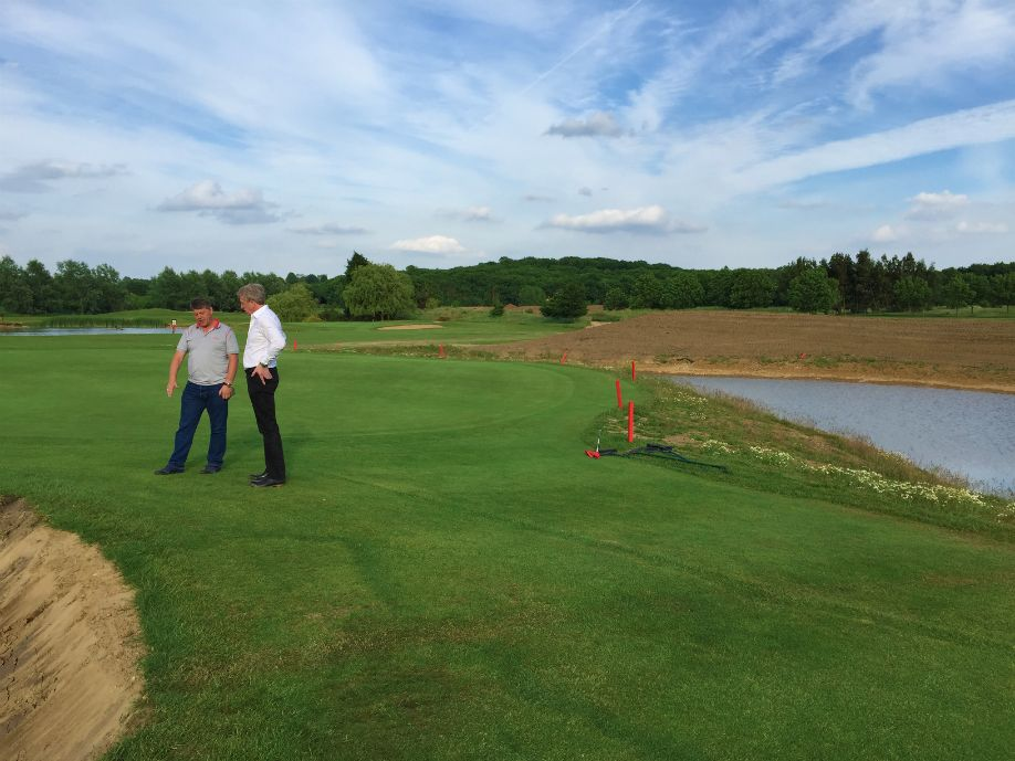 Course Owner Jamie Saitch and Turfdry MD Melvyn Taylor discuss construction of a new bunker, next to newly constructed pond.
