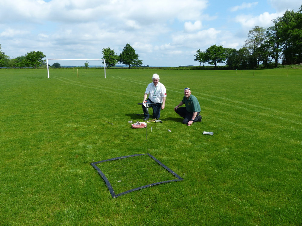 Institute of Groundsmanship Regional Advisor for the West Midlands Kevin Duffill carries out pitch inspection as part of his preparation of detailed written report.