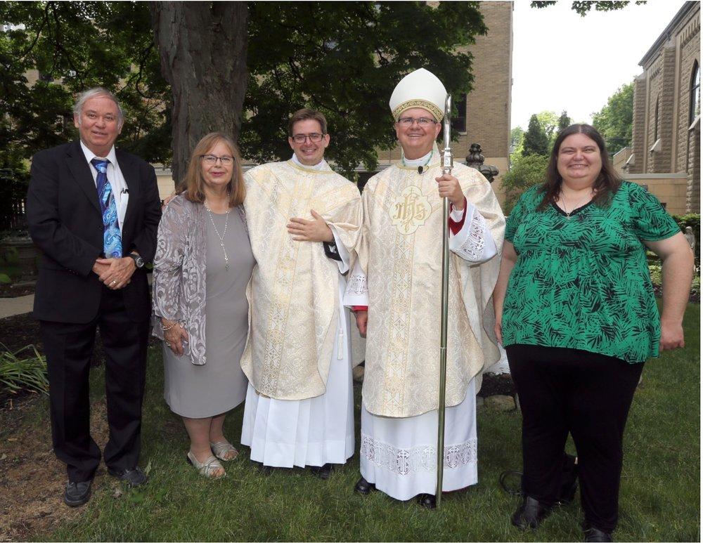 Fr. De Oreo with family.jpg