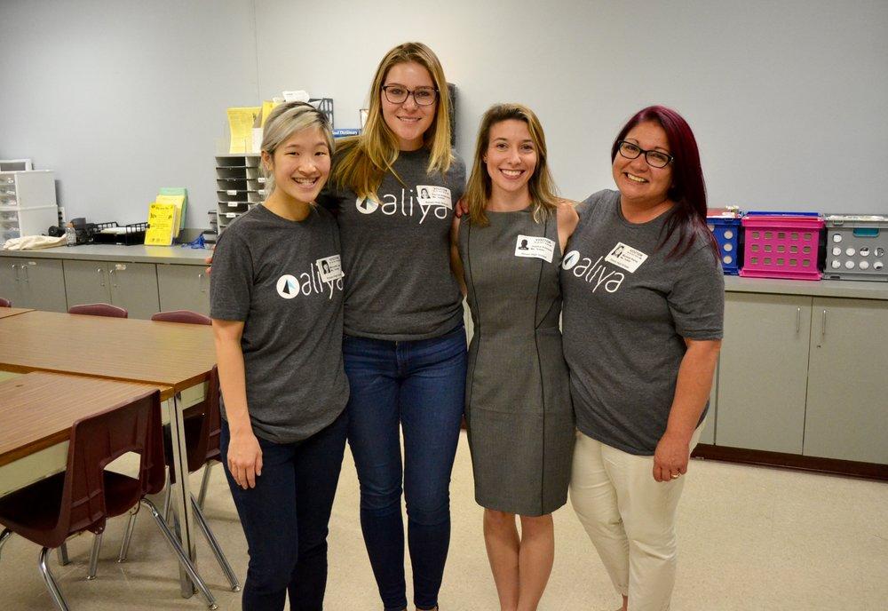 Aliya volunteers at Rouse High School.