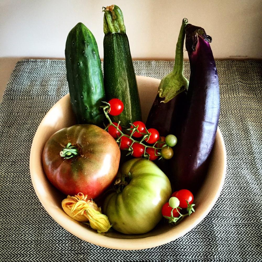 Vegetables from my grandmother's garden, Handwoven table runner underneath.