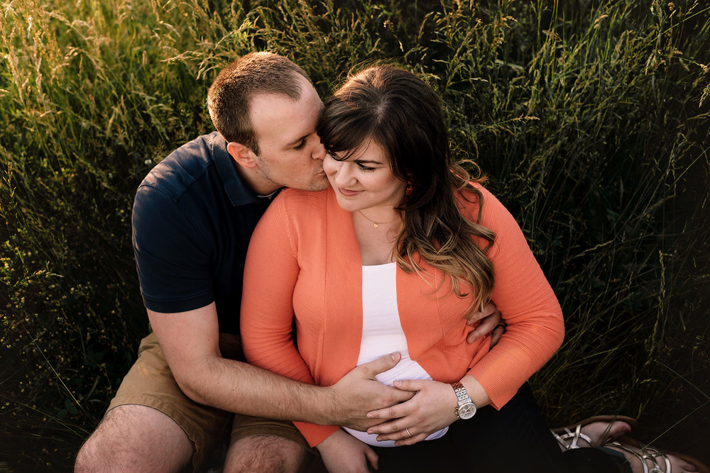 Baltimore Maryland Maternity Newborn Photographer couple snuggling
