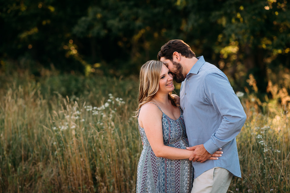 maternity photography pregnant woman in dress with husband tall grasses Baltimore Photographer