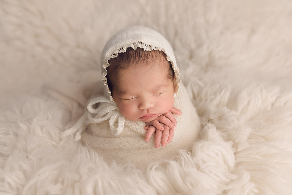Baltimore Maryland Newborn Photographer Jessica Fenfert baby girl on cream flokati potato sack