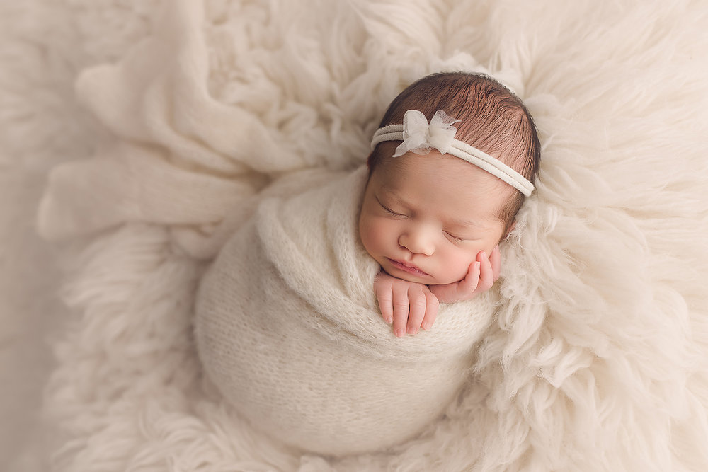 Baltimore Maryland Newborn Photographer Jessica Fenfert baby girl on cream flokati
