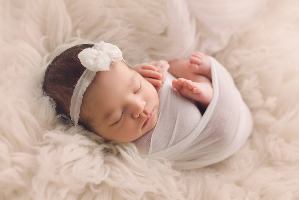 Baltimore Maryland Newborn Photographer Jessica Fenfert baby girl on cream flokati wrapped