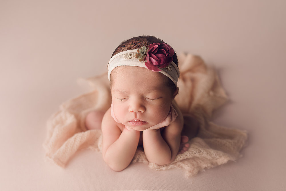 Baltimore Maryland Newborn Photographer Jessica Fenfert baby girl on pink froggy pose