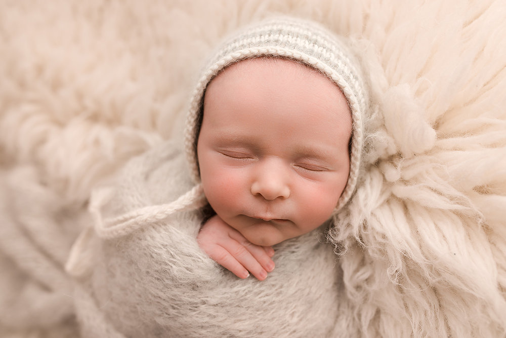 Baltimore Maryland Newborn Photgrapher Jessica Fenfert baby boy cream flokati