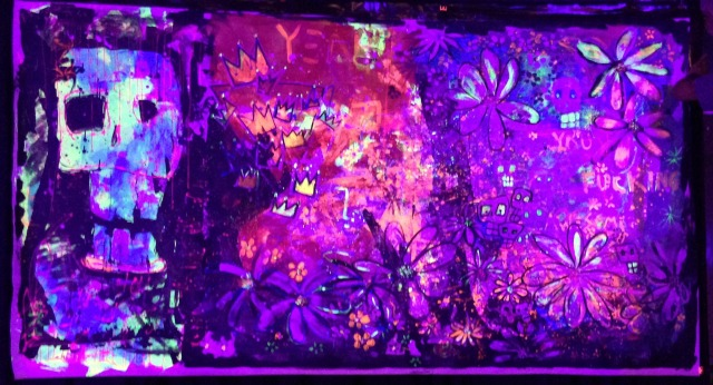 This is a 5' x 9'  black light painting that was used as a backdrop for the stage.