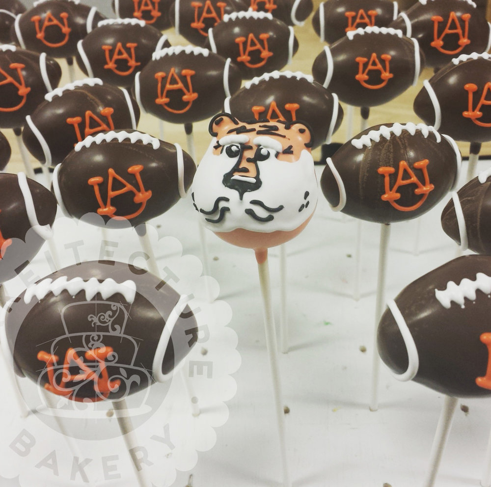 Cakeitecture Bakery football pops.jpg