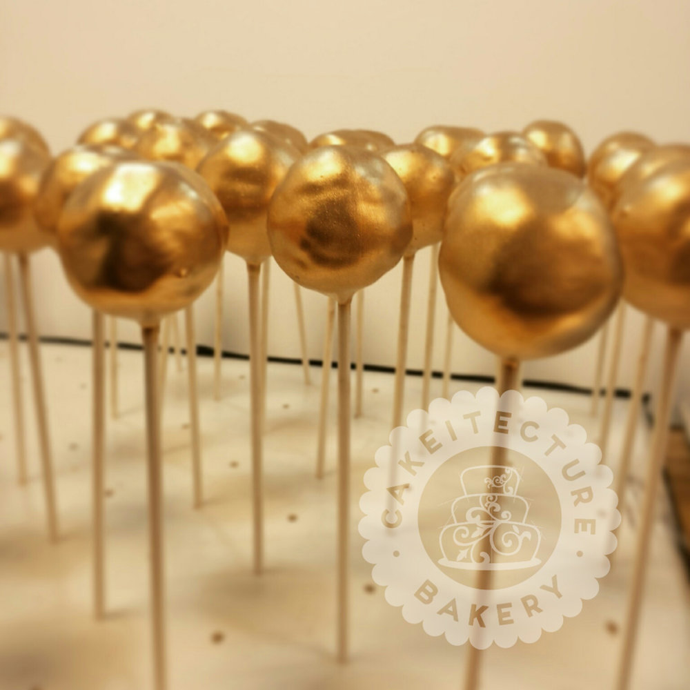 Cakeitecture Bakery gold pops.jpg