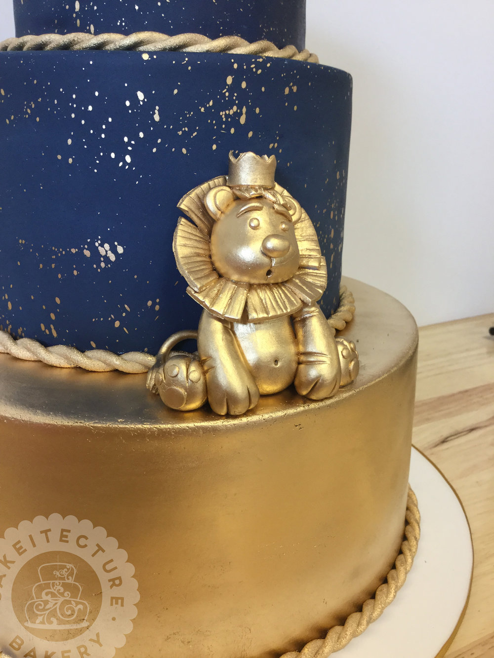 Cakeitecture Bakery 1703 gold lion cake topper.jpg