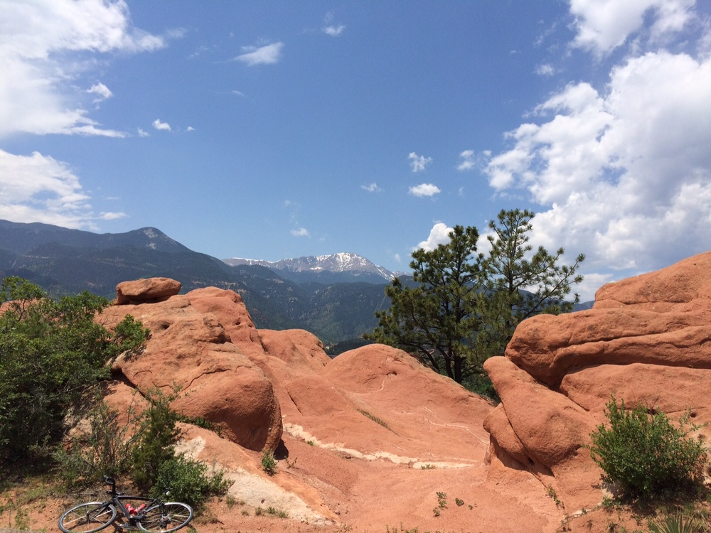 Here is a view of Pikes Peak from the top of a rock formation in the Garden of the Gods.