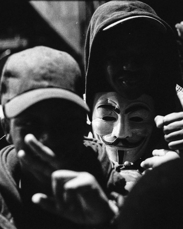🎭 . [Beneath this mask there is more than flesh, Beneath this mask there is an idea … and ideas are bulletproof.] . #26October . Canon AE-1, 50mm f1.8 , HP5+ Pushed all the way to 3200, developed myself 🙏🏽