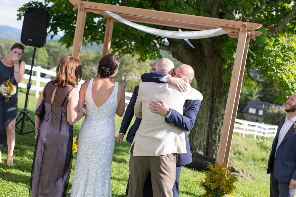 groom at stone tavern farm wedding ceremony