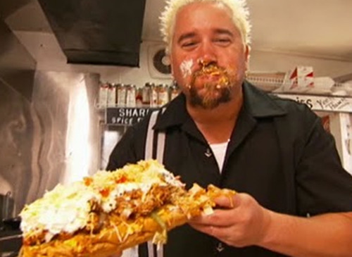 Guy Fieri holding his ticket to Flavortown