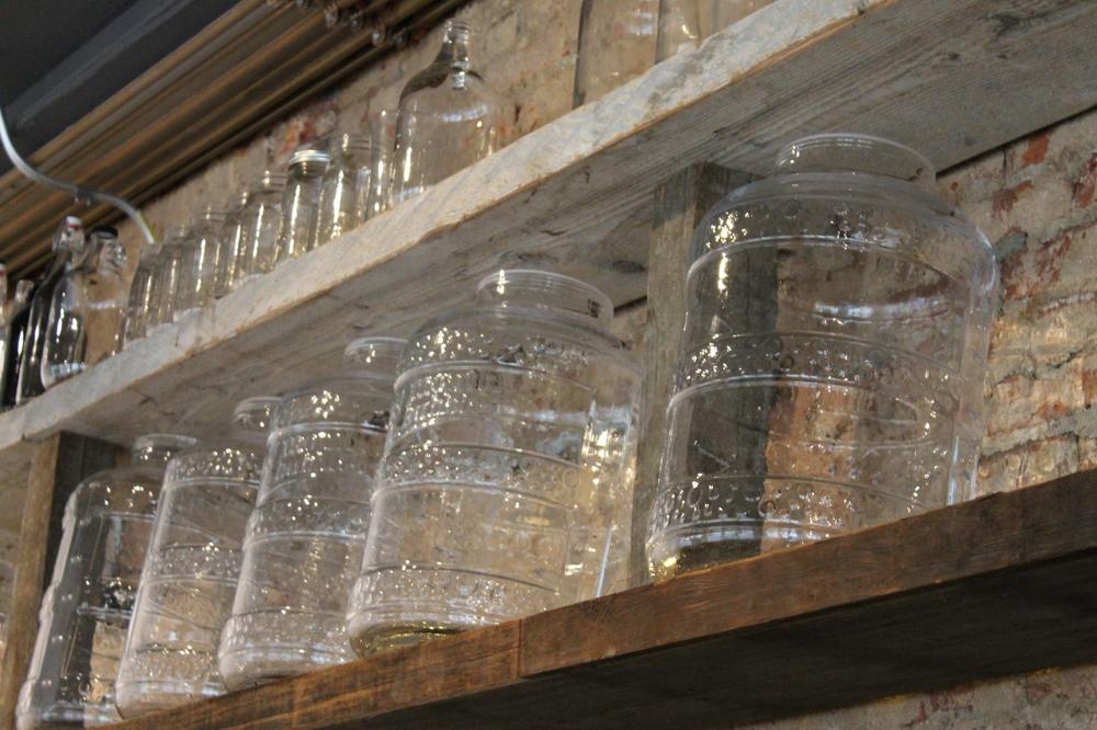 Beautiful glass jugs line the walls