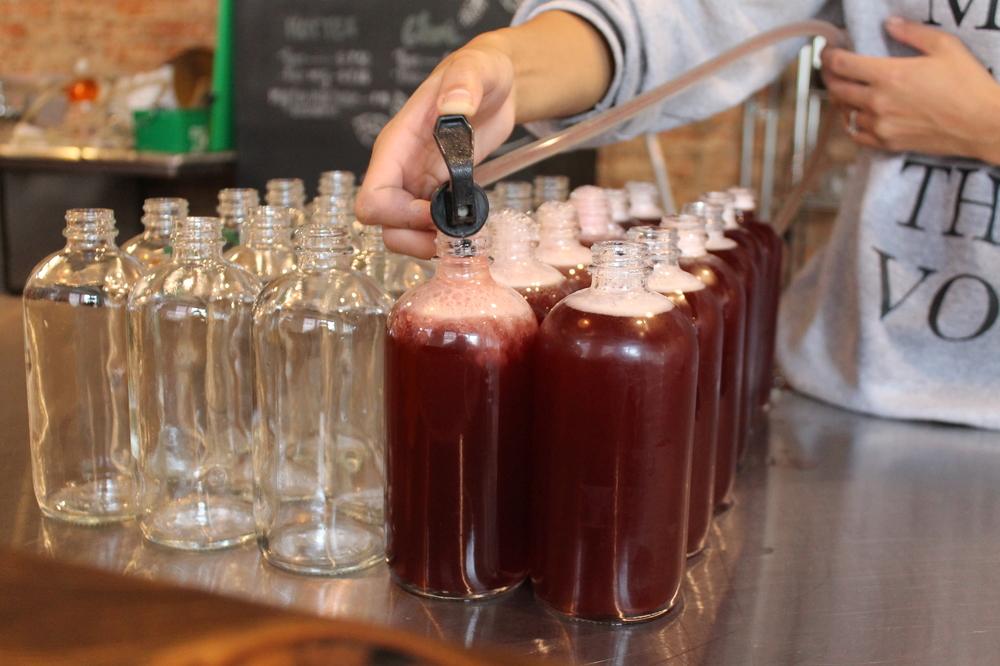 Bottles of Immunity Elixir being filled