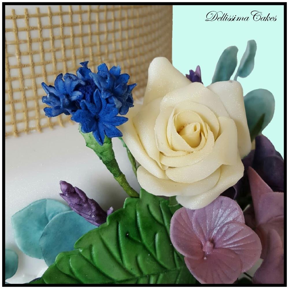 Pinecone Wedding Cake flowers hessian.jpg
