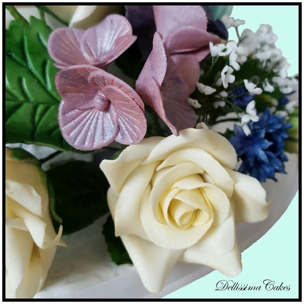 Pinecone Wedding Cake flowers.jpg