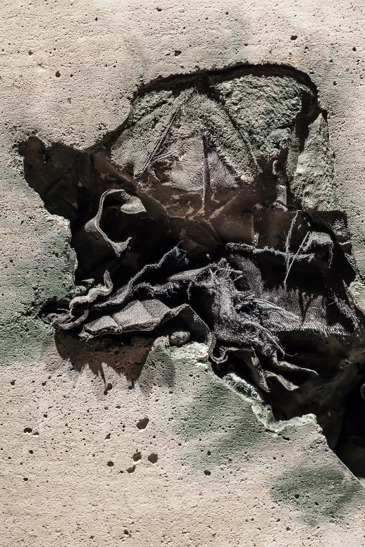 Unlikely process,2015(detail) Oilpaintonoakpanels,concrete,clothes.Courtesyofhttp://carolinemonnet.ca/