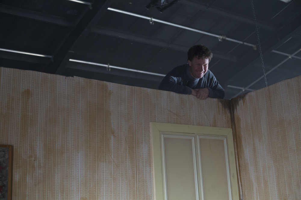 Construction Manager Duncan McFarlane fits reclaimed wardrobe doors in the bedroom.jpg
