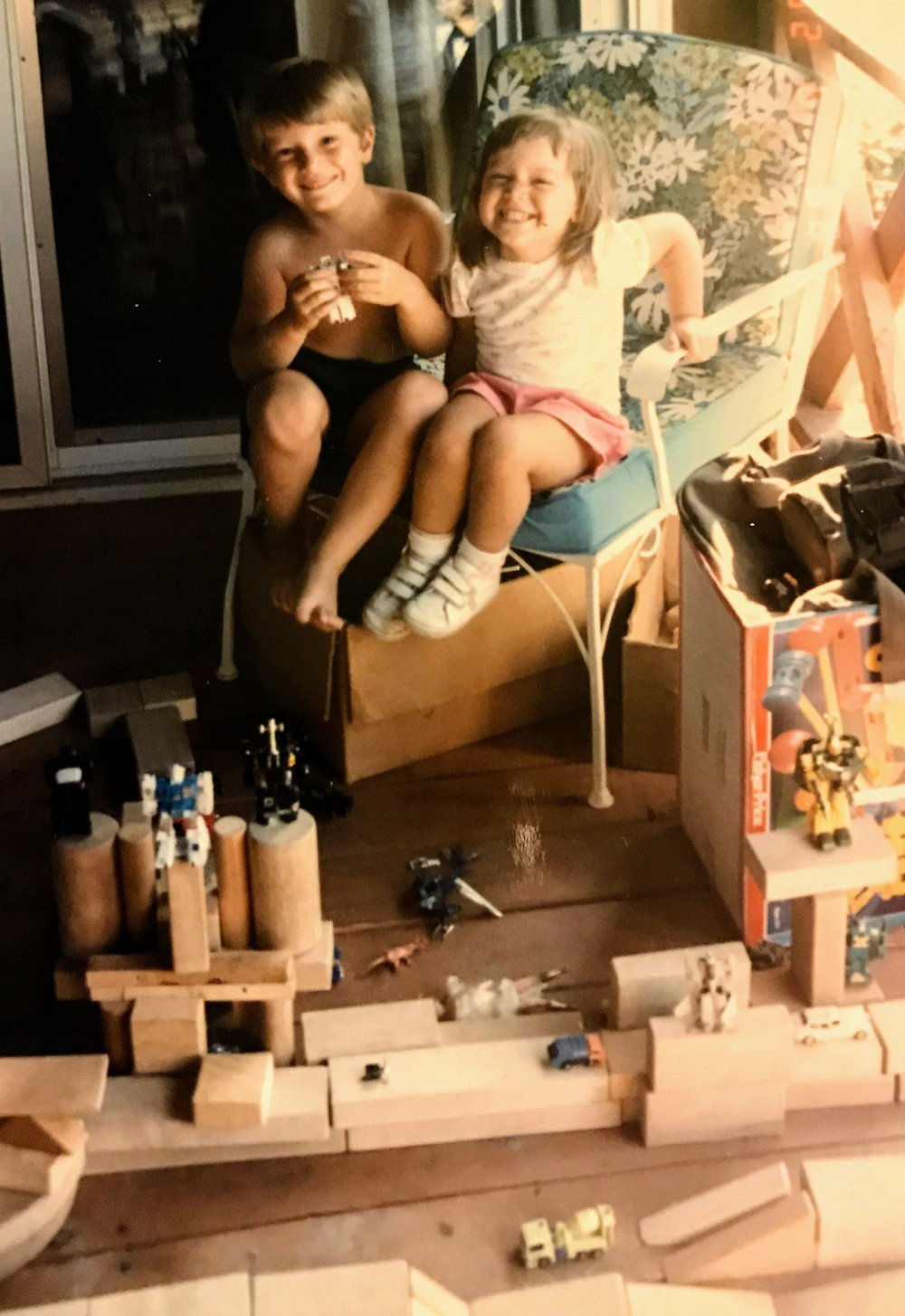 "My sister and I play out a ""winner takes the universe"" battle in Erie, PA circa 1987"
