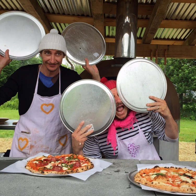 what's better than a man making pizza? how about two, wearing wes anderson hats!