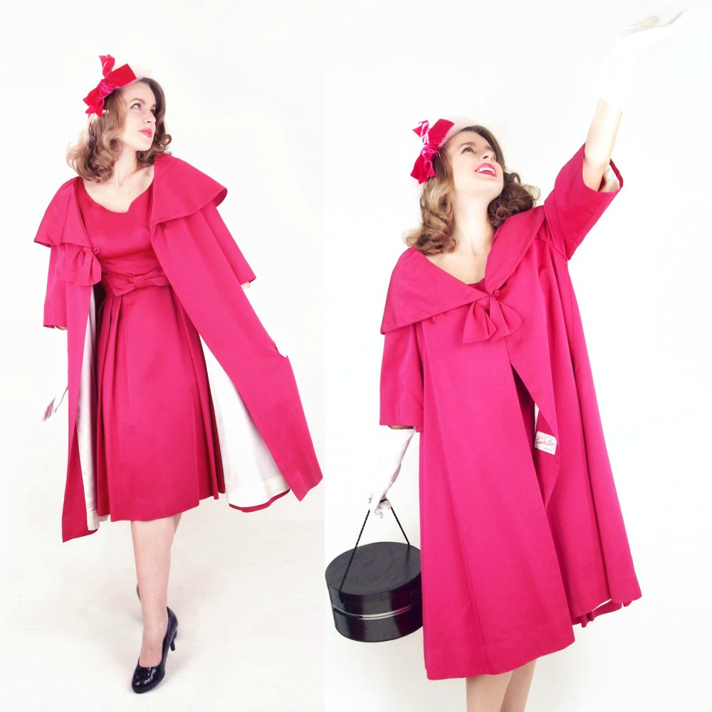This rosy dress and swing coat is labeled Sandra Sage