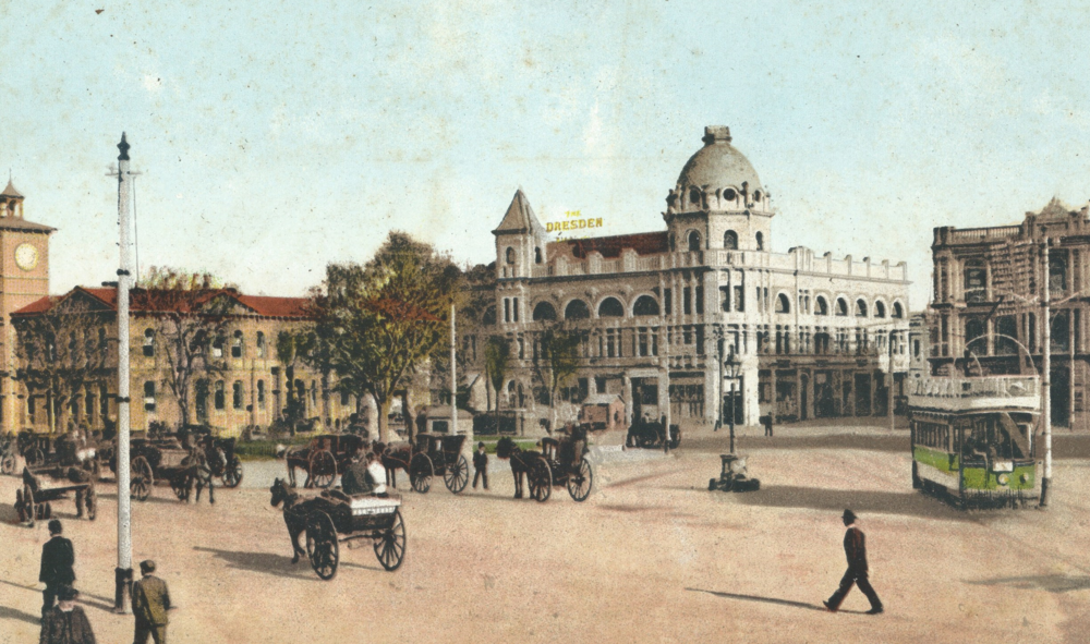 Postcard showing Cathedral Square, with the old Dresden Piano building in the background.