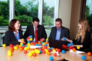 group of business people playing and being creative in the office