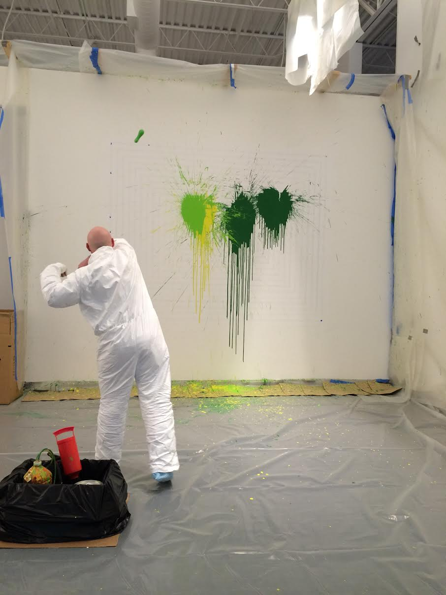 "Cucullu in action, casting the initial ""paint bombs"" onto the wall."