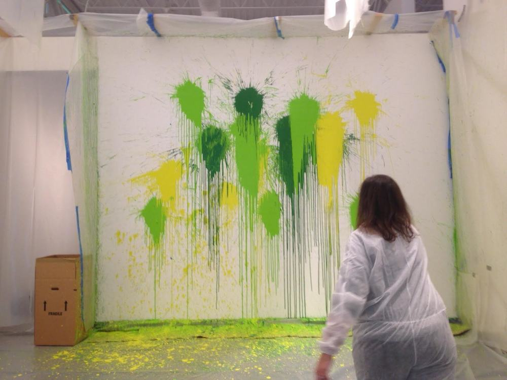 "Chief Curator Staci Boris throwing a ""paint bomb."""