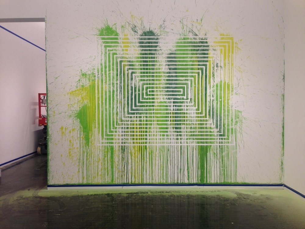 Santiago Cucullu's  Green Hell  lived up to its name. Sanding the latex paint and pieces of balloon proved to be quite a process, but it will remain underneath the paint as a permanent part of the wall.
