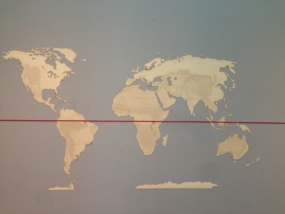 This intricate, laser-cut map of the world both shows where each of the twenty-five examples are located as well as delineations of climate zones.