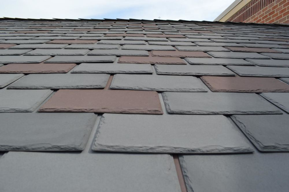 Seemingly slate roofing material, these tiles are comprised of recycled plastics.
