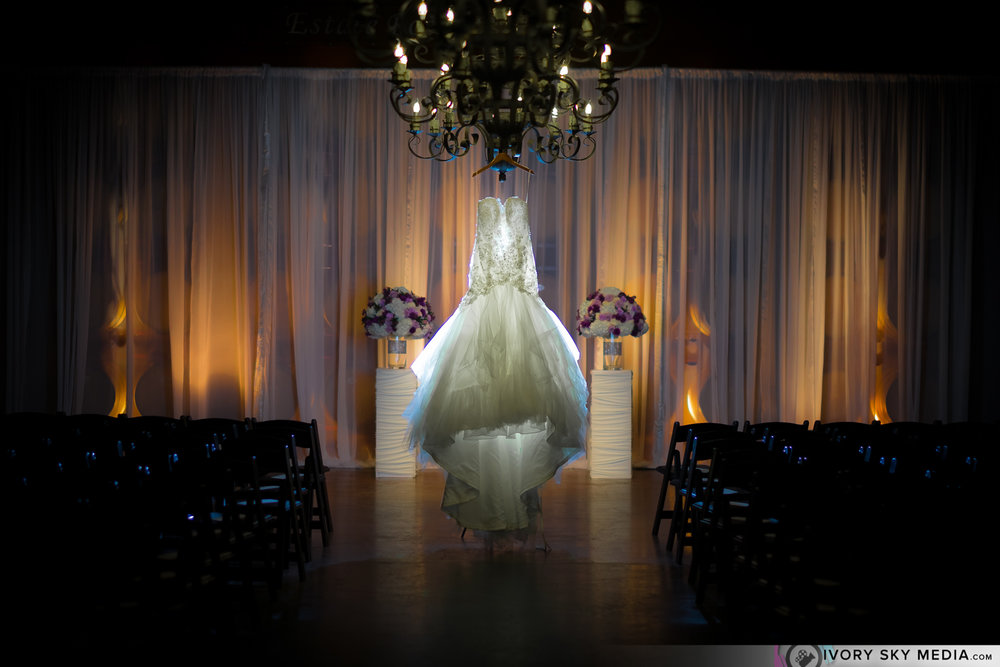 The wedding dress hanging from the wine cellar chandelier, a bit intense, but we love a little drama.