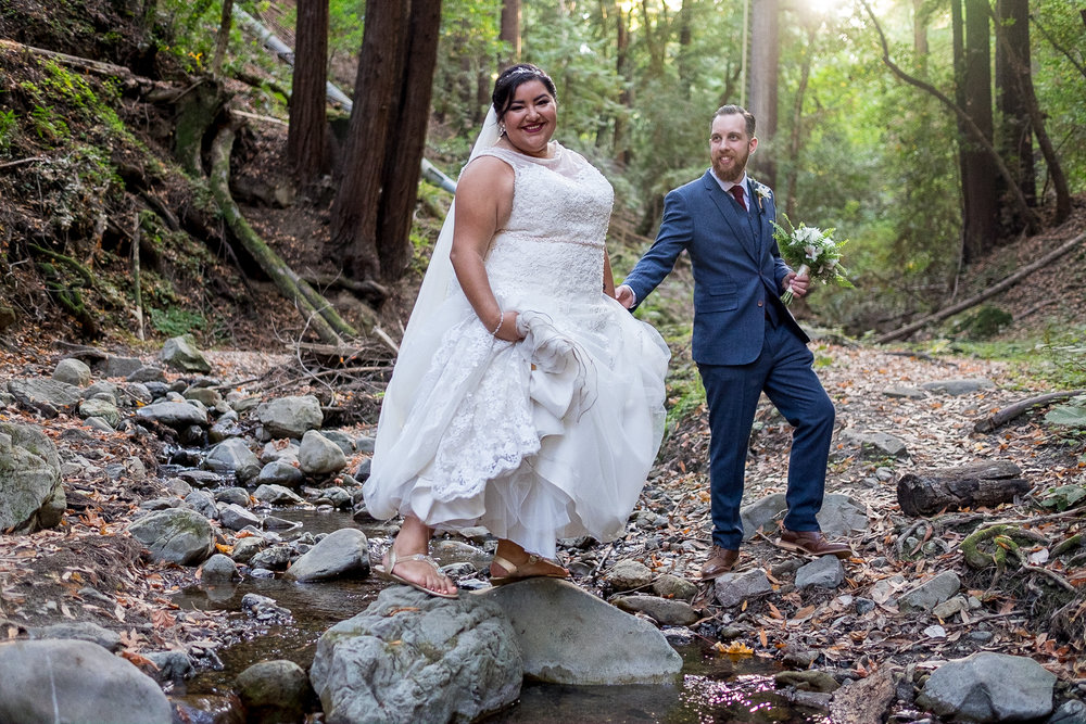Bride and Groom crossing the creek to sneak a private moment
