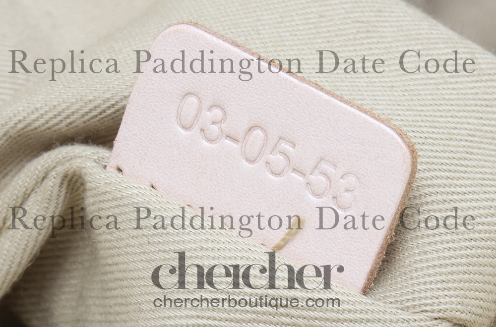 A replica Paddington bag's date code heat stamped on real calf leather tab.