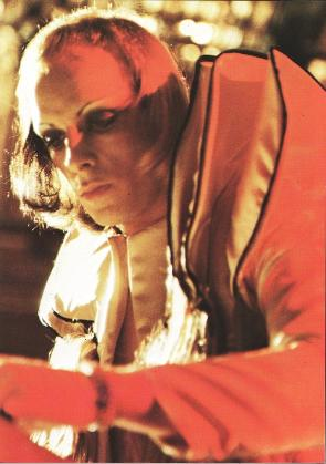 Brian Eno on stage with Roxy Music, circa 1973.