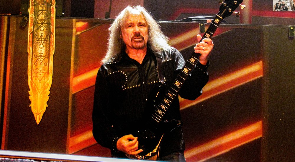 Original bassist Ian Hill holds down the fort from his spot on the stage from which he never leaves as long as songs are playing.
